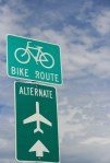 An alternate to flying?? Bikes? Cool sign!